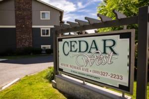 Cedar West Apartments parking lot sign