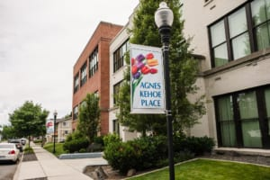 Agnes Kehoe Place Apartments build logo and front