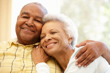 Elderly Couple of color smiling